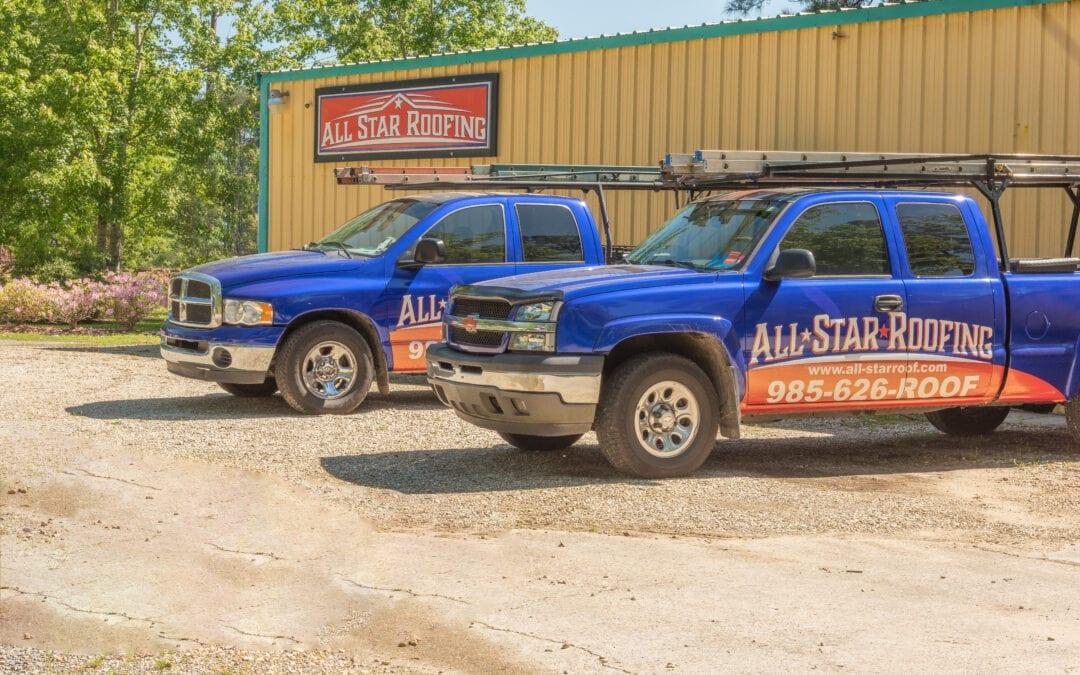 all star roofing trucks outside building
